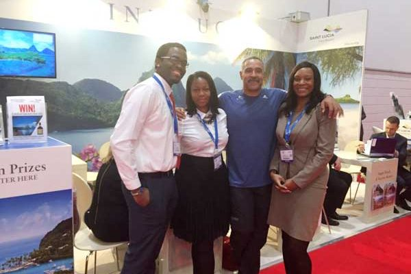 Image: Olympian Daley Thompson at SLTB reps promoting St. Lucia
