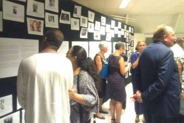 Image: Viewing pictures of victims of the attack.