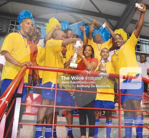 Image: Digicel Representative presenting the championship trophy to SLASPA Captain Andrew Charles (Photo Anthony De Beauville)