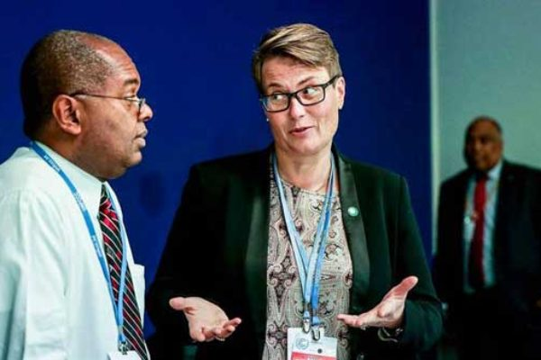 Image: Fletcher with a delegate at COP21