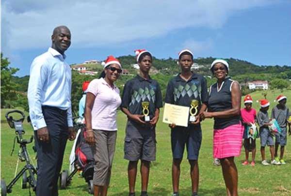 Grow Well Cup winners Samuel Richelieu (2014) and Rayshorn Joseph (2015) with The Landings General Manager Wilbert Mason, Grow Well monitor Christina Jules and program director Colleen Newman.