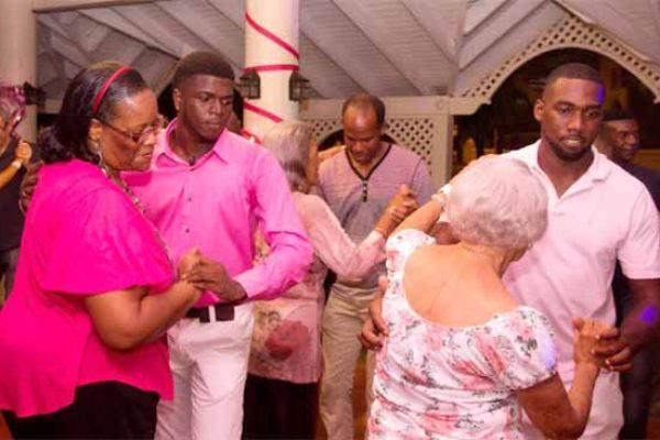 Image: Salsa dancers go at it.