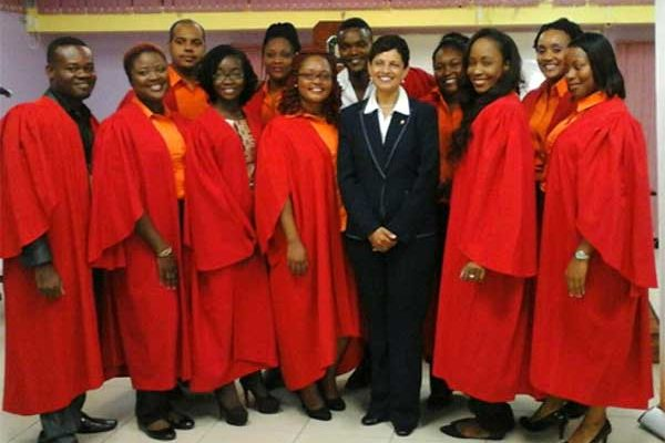 Image: Members of the newly-inducted Executive of the Open Campus Student Guild happily surround Dr. Luz Longsworth, Pro Vice-Chancellor and Principal of the Open Campus of The University of the West Indies. Fourth from right is the current Chair of the Open Campus Saint Lucia Student Guild, Mrs Marcia DolorLashley.