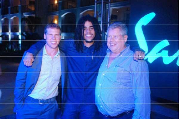 "From Left to Right: Adam Stewart, CEO of Sandals Resorts International, Skip Marley, grandson of the late reggae icon Bob Marley and son of Cedella Marley, Gordon ""Butch"" Stewart, Chairman of Sandals Resorts International"