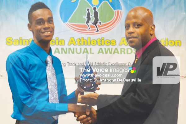 Image: (L-R) Junior male athlete for the year high jumper Ace Louis receiving his award from SLAA President Wayne Burton (Photo Anthony De Beauville)