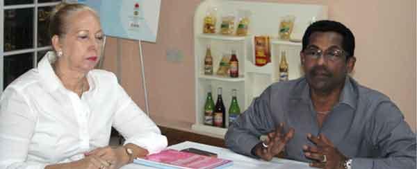 Image: SMA Past President, Paula Calderon, and current SMA President, Ronald Ramjattan. [PHOTO: Stan Bishop]