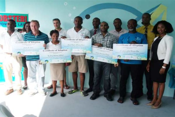 """Image: Six dive shops affiliated with hotel properties in Saint Lucia received an """"Adopt a Reef"""" certificate in recognition of their willingness to be trained to support reef monitoring activity along the island's coast."""