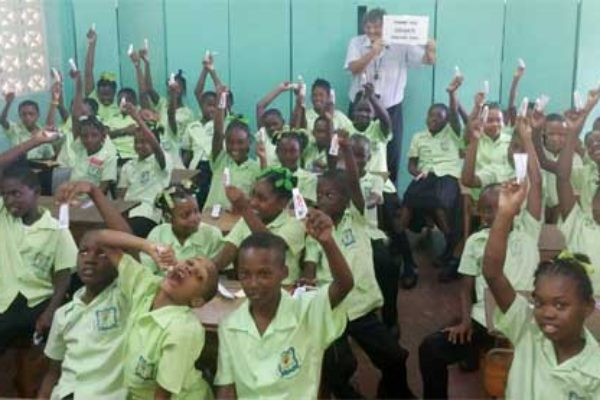 Image: Stephen says thank you to donor Colgate with students of the Millet Primary School during a recent visit.