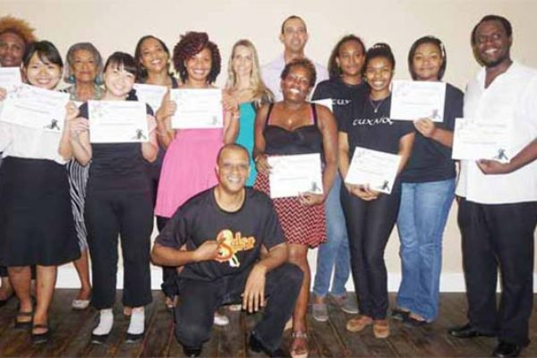 CEO Dr. Peter St. Rose (centre) with Salsa graduates.