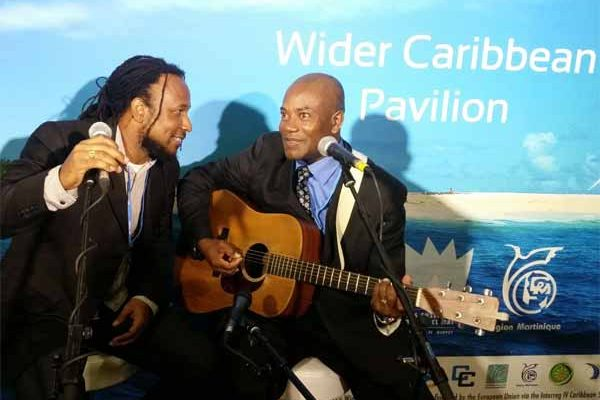Image: Caribbean artistes perform at UN Climate talks in Paris.