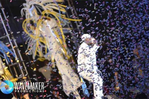 TJ showered with confetti during an appearance in Trinidad.