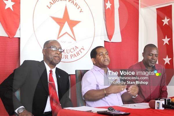 Image: Dr. Long (center) flanked by SLP Chairman, Claudius Francis(left), and General Secretary, Leo Clarke(right)