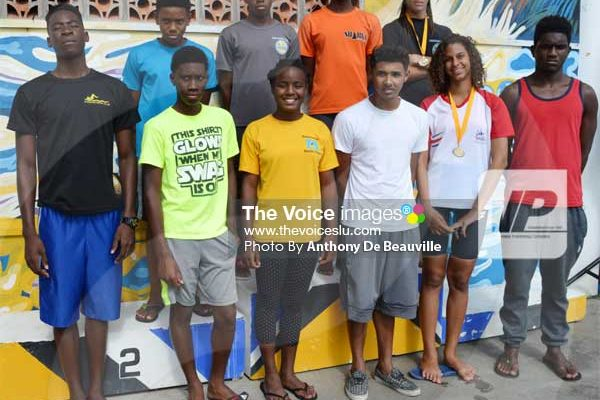 Image: 10 members of the team after Sunday's CARIFTA Trials at the RHAC front row (l-r) Omar Alexander, Devin Boodha, Mikaili Charlemagne, Mark Emanus, Katie Kyle and Christopher Phillip. Back row) JayhanOdlum - Smith, Jamal Archibald, Eden Crick and TerrelMonplaisir [PHOTO: Anthony de Beauville]