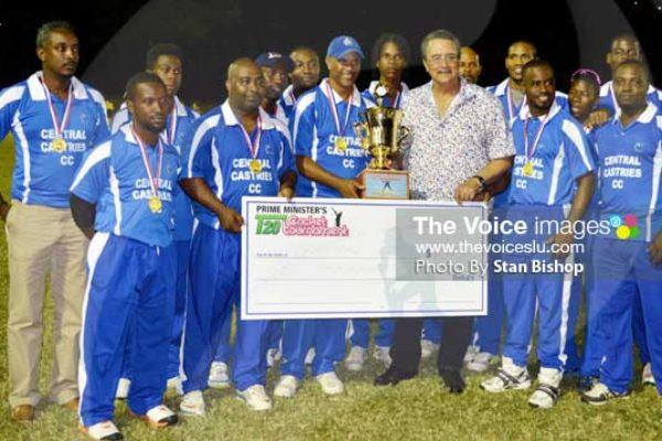 Image: A photo moment for St. Lucia Prime Minister with the winning champions Central Castries [PHOTO: Anthony De Beauville]