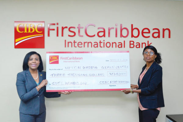 Image: Country Manager Ladesa James-Williams presents cheque to director of Uptown Girls Centre