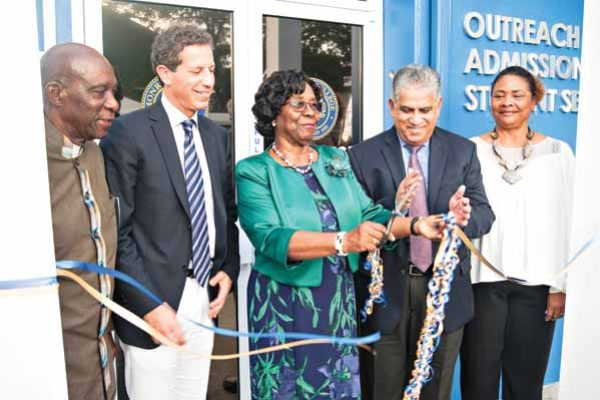 Image: Governor General, Dame PearletteLouisy cuts ribbon to ceremoniously open new location. Also in photo: Director of Administration, Gus Small, Executive Vice President, Marc Jerome, Sonia Alexander, Director of Academics and Senior Vice President, Dr. Alex Ephrem. (Photo: Bill Mortley)