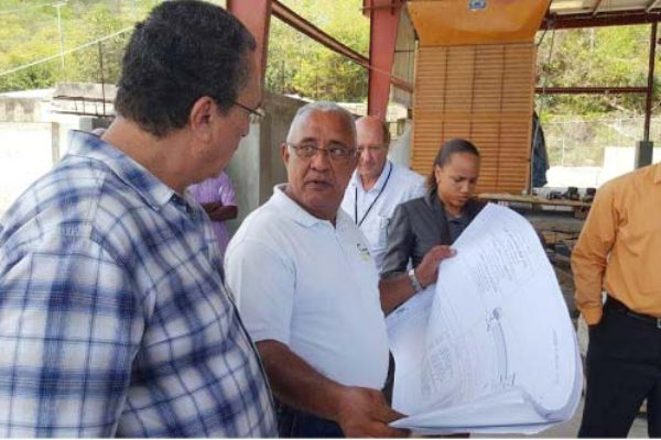 Image: Dr. Anthony (left) visiting the construction site.