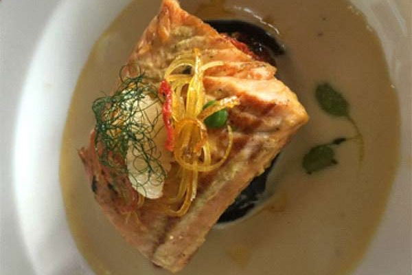 """Image: Edna Butcher's Winning Dish """"Pan-Seared Salmon with Black Squid Ink Ravioli filled with a Chorizo Risotto"""