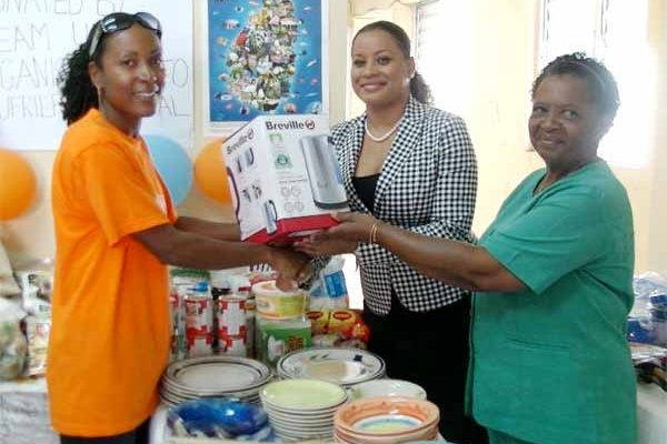 Image: Esnard presenting gifts to the Soufriere hospital.
