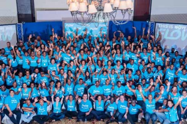The FLOW team in St. Lucia comes together for a massive celebration of the launch.
