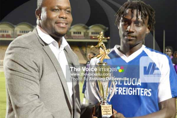 Image: (L-R) Trinidad and Tobago professional footballer Stern John presenting the MVP awared to Gros Islet player Troy Greenidge. (PHOTO: Anthony De Beauville)