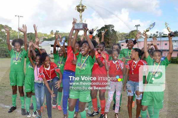 Image: VFS captain ShakereClasse holds the championship trophy aloft in celebration. [PHOTO: Anthony de Beauville]