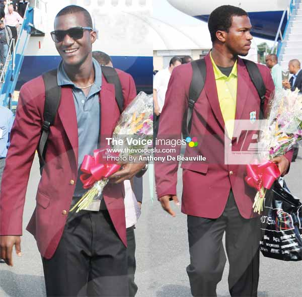 Image: (L-R) World champions Darren Sammy and Johnson Charles. [PHOTO: Anthony De Beauville]