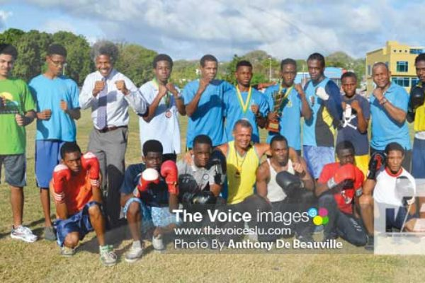 Image: A photo moment for some of the boxers that will be on show today with PS Youth Development and Sports Dr. Anthony George and SLBA President David Christopher (Photo Anthony De Beauville)