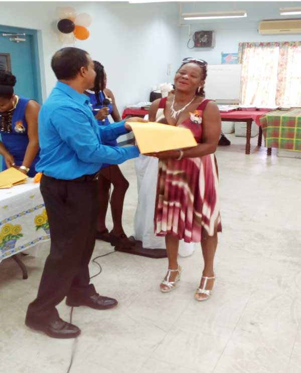 Image: One of the farmers receives her certificate.