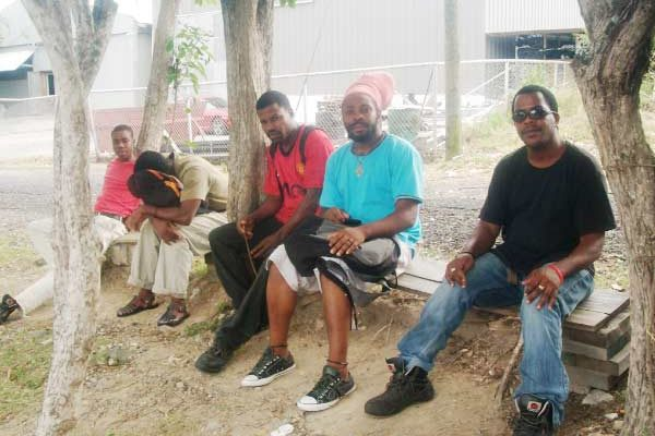 Image: Some of the workers outside the plant during the lock out.
