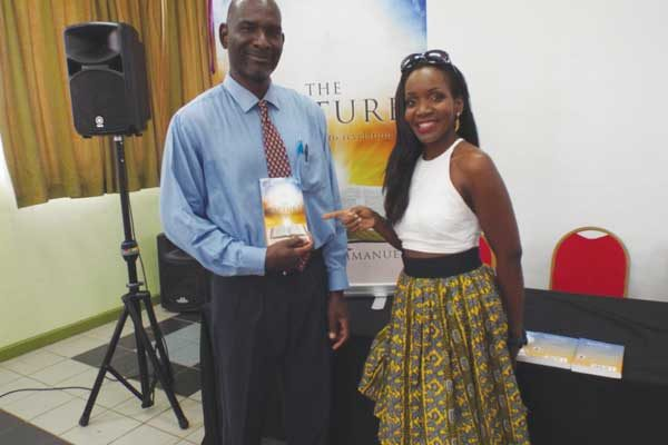 img: Claudius Emmanuel and Linda Berthier at the book launch.
