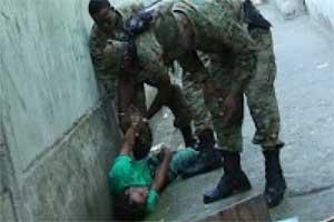 An injured person lies in a drain.