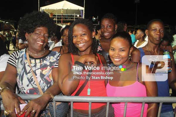 "Image: These patrons were all smiles after Menell's spellbinding performance of ""Rivers of Blood"" at the Calypso Monarch. [PHOTO: Stan Bishop]"