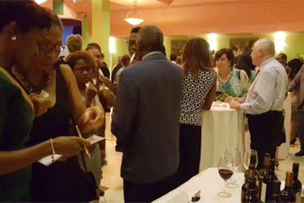 Image: Guests viewing the wine selection from event sponsors La Cantina Wines and Barbay Ltd.