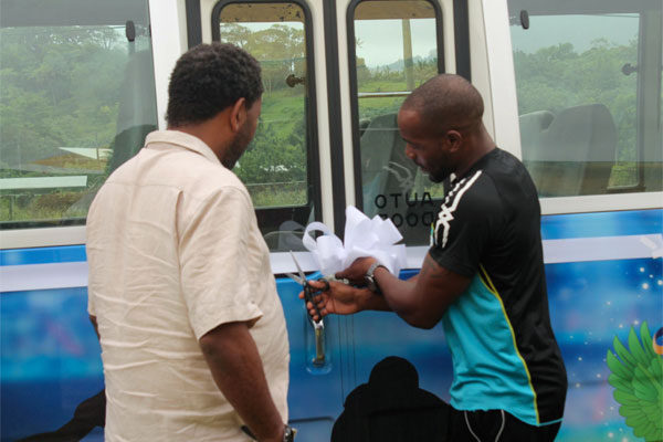 Image: (L-R) SLFA President Lyndon Cooper and Elite athlete Javelin thrower Albert Reynolds cut the ribbon commissioning St. Lucia team bus.