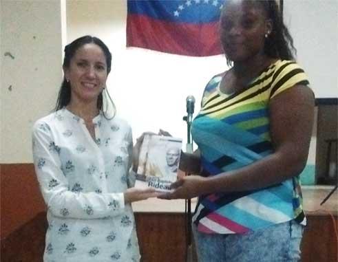 Image: Venezuelan Ambassador presents copies of the book on Bideau to one his descendants