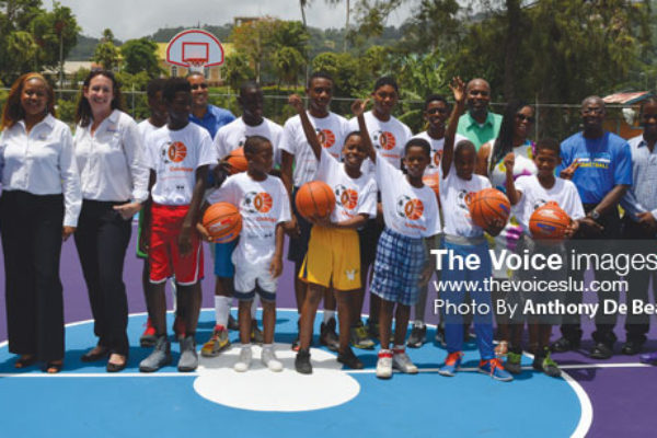 "Image: A photo moment for Sandals Doundation, Dwayne Wade Foundation, Kenneth ""Wriggler"" King committee, BFTF young and aspiring players Photo Anthony De Beauville)"