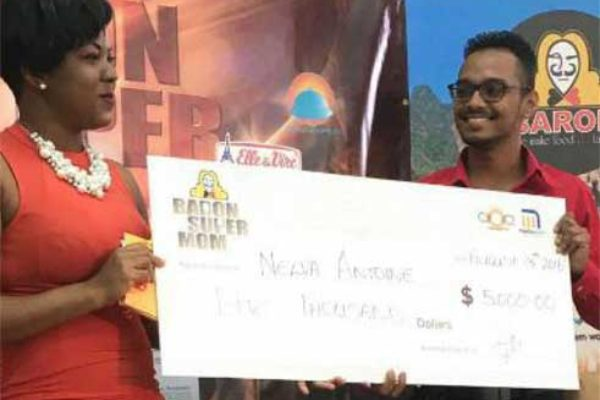 Antoine picks up her $5,000 cheque.