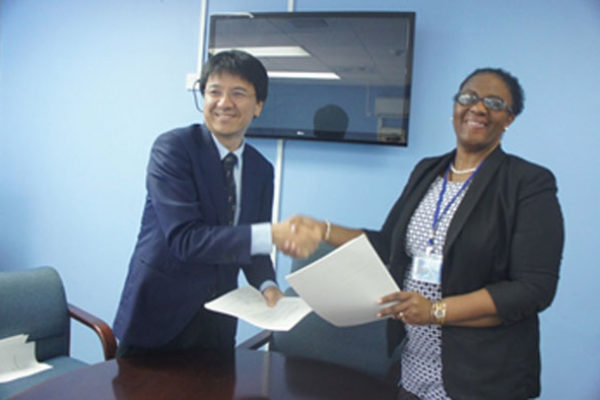 IMG: Mrs. Allison A.Jean, Permanent Secretary, Ministry of Infrastructure and Mr. Sakabe, leader of the preparatory survey team of JICA following the signing of the Minutes of Discussions.