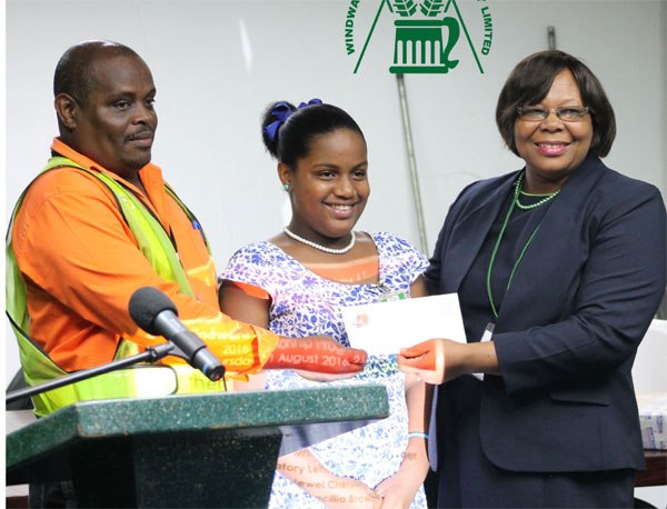 Image: Nadia Joseph receiving her scholarship from Mrs. Browne, Accounting Manager.