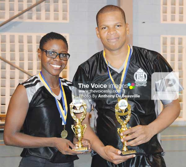 Image: L-R) Police representatives Signa President and Daryl Evans MVP's of the Tournament. (Photo: Anthony De Beauville)