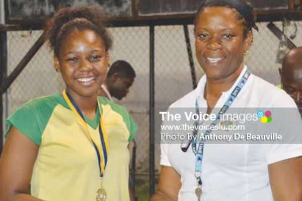 (L-R) SALCC Jedda Alcee receiving her gold medal from School Sports Coordinator Isabelle Marquis following the Secondary Schools Volleyballs finals between SALCC and SJC (Photo: Anthony De Beauville)