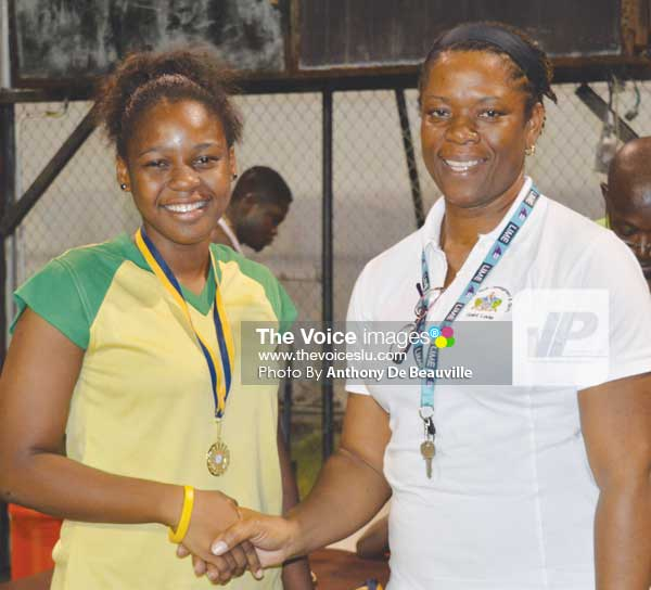 Image: (L-R) SALCC Jedda Alcee receiving her gold medal from School Sports Coordinator Isabelle Marquis following the Secondary Schools Volleyballs finals between SALCC and SJC (Photo: Anthony De Beauville)