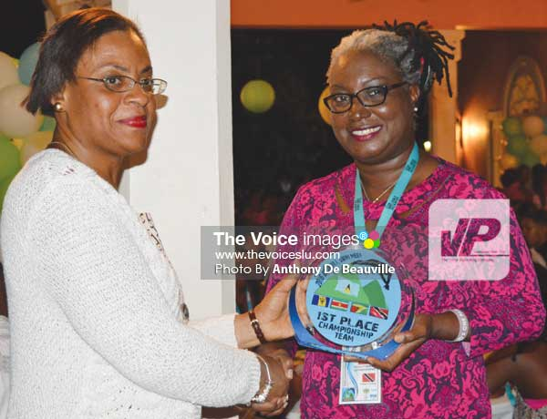 Image: (L-R) SLASA President Carol Mangal presenting Trinidad and Tobago Team Manager with 1st Place Championship Trophy. (Photo Anthony De Beauville)