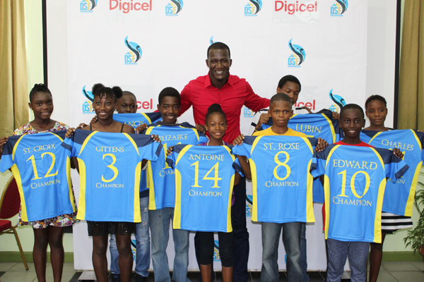 Image: Sammy poses with nine of the recipients at yesterday's function.