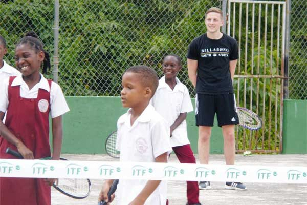 Image: Students getting tennis lessons.