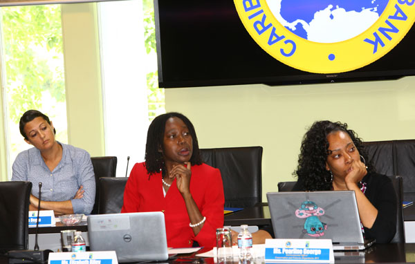 img: Participants during the Conference – from left to right: Karima Degia, Baird & Associates; Elizabeth Riley, Caribbean Disaster Emergency Management Agency; Pearline George, Conservation and Fisheries Department, British Virgin Islands