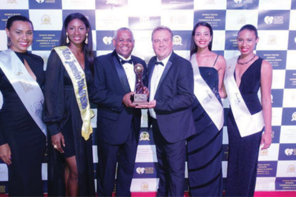 img: : [From left to right: World Travel Awards representative, Ashlie Barrett, Miss Jamaica World 2016, David Shields, Vice President of Sales, Island Routes Caribbean Adventures, Chris Frost, Vice President, World Travel Awards, World Travel Awards representative, World Travel Awards representative]