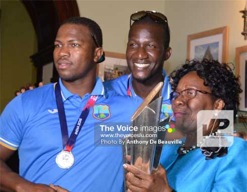 Daren Sammy and Johnson Charles share a moment of glory with St. Lucia's Governor General Dame PearletteLouisy. (PHOTO: Anthony De Beauville)