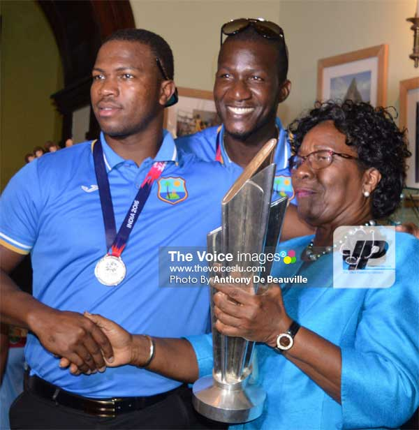 Image: Daren Sammy and Johnson Charles share a moment of glory with St. Lucia's Governor General Dame PearletteLouisy. (PHOTO: Anthony De Beauville)